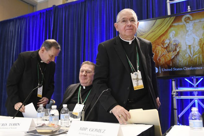 Archbishop Jose H. Gomez, right, of Los Angeles, with Bishop Michael F. Burbidge, left, of Arlington, Va., and Cardinal Joseph William Tobin, of Newark, N.J., exits a news conference after being elected president of the United States Conference of Catholic Bishops during their 2019 Fall General Assembly in Baltimore.