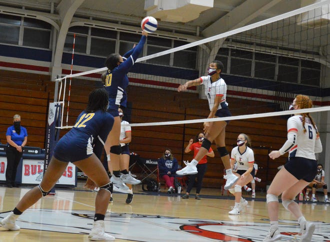Senior co-captains Mia Arnold (3) and Kara Walker are hoping to lead the Terry Sanford volleyball team to the top of the Patriot 4-A/3-A Conference this season.
