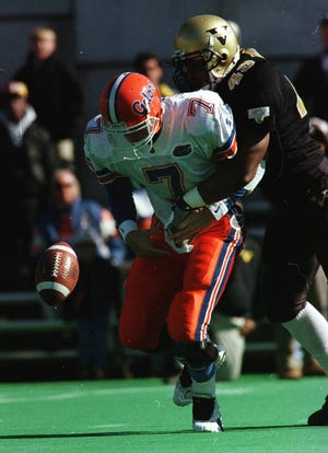 Vanderbilt's Jamie Duncan forces Florida quarterback Danny Wuerffel to fumble in the Nov. 9, 1996 game in Nashville.