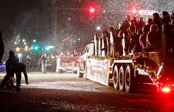Fake snow fills the air as it leaves a float during the 42nd annual West Alabama Christmas Parade sponsored by Tuscaloosa County Parks and Recreation Authority in downtown Tuscaloosa on Monday, Dec. 4, 2017.    [Staff Photo/Erin Nelson]