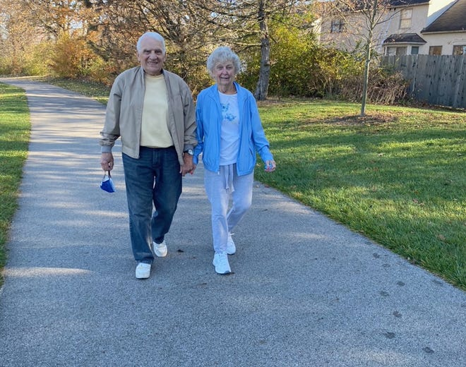Westerville residents Frank Palmiero and Loretta Sulich walk at their neighborhood park, Hoff Woods Park, 556 McCorkle Blvd. The couple's goal is to continue walking more than a mile a day for 365 consecutive days.