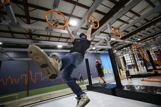 Robert Lowery of Pataskala makes his way across one of the ninja courses Nov. 19 at Play: CBUS, 535 Lakeview Plaza Blvd. in Worthington. The indoor adventure center opened Nov. 6.
