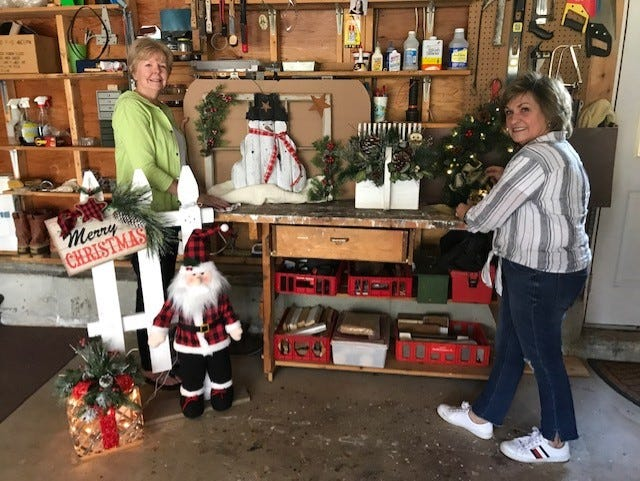 Members of the Colonial Garden Club of Marlborough have created a contact-free 42nd Pear Tree Boutique.. In the photo, in the workshop of Priscilla Dalamangas are Priscilla, at left, and Joanne Mahoney.