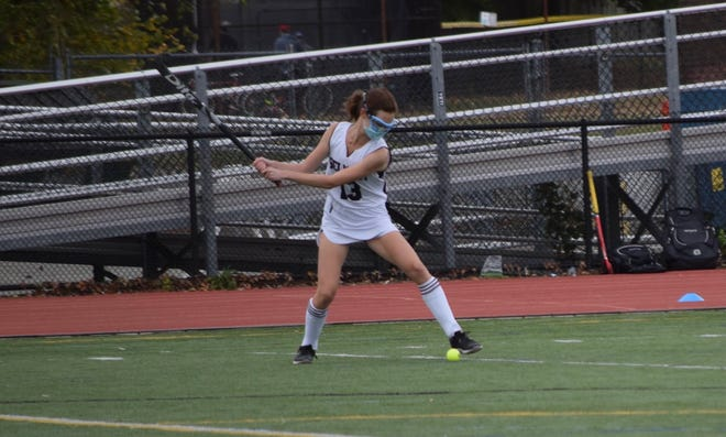Senior Ally Donahue winds up to hit the ball up the field.