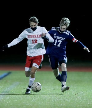 Hingham's John Sula battles with Pembroke's Luke Saia for possession of the ball during third quarter action of their game in the Patriot Cup semifinal at Pembroke High on Thurday, Nov. 19, 2020.