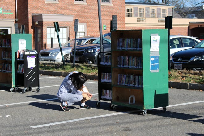 Cary Library brought some of their bookshelves outside for a pop up event, allowing people to browse like they normally would inside.