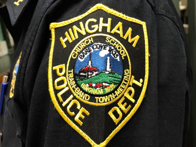 Hingham Police arrested a Randolph man they say attacked two officers.