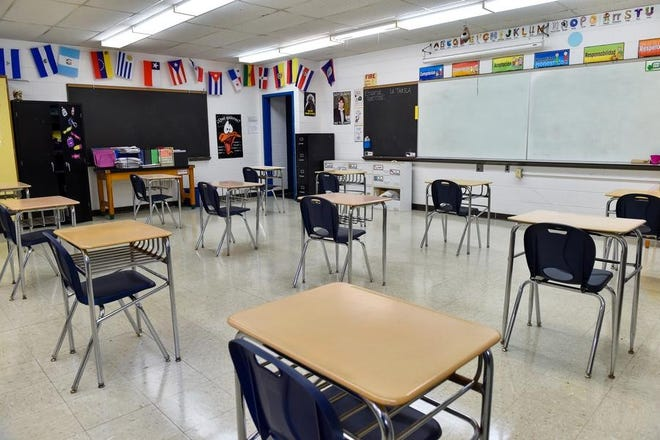 Swampscott school leaders hit the pause button on plans for more in-person learning each week and will look at the idea again after student testing in January.