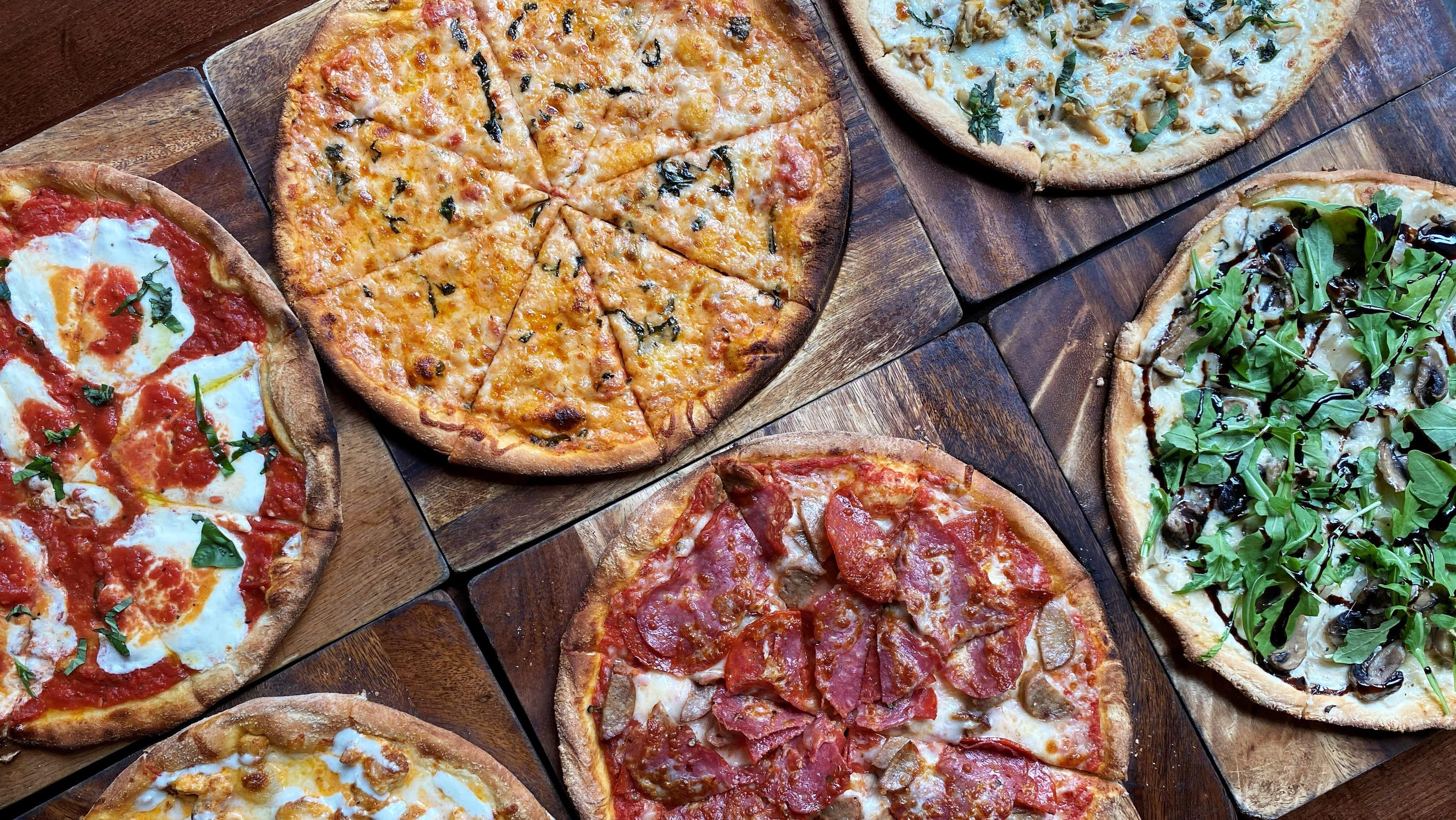 97346495 26e9 4179 8d0e 68ebd5c170ec pizza jpg?crop=4031,2268,x0,y302&width=3200&height=1801&format=pjpg&auto=webp.