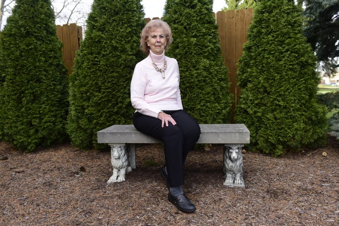 Mary Fox sits proudly on the bench outside her Bucyrus home where she has photographed a countless number of people she has written about over the years.