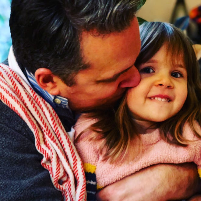 Enquirer food writer Keith Pandolfi with his daughter, Sylvia, last Thanksgiving.