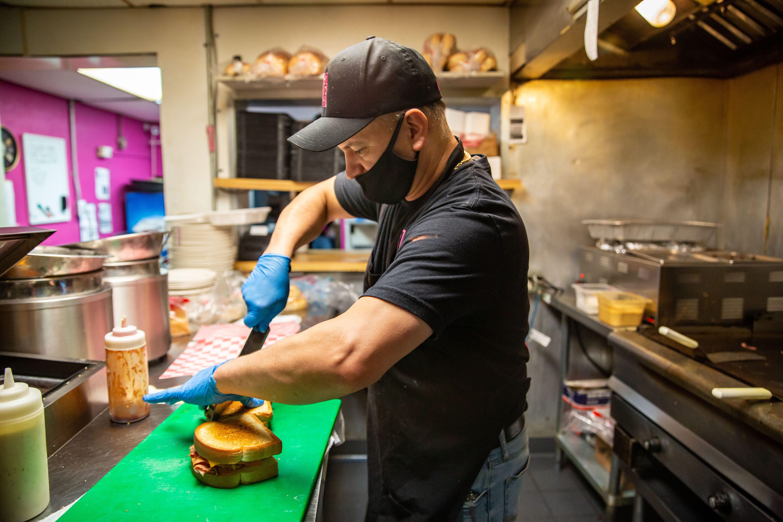Anibal Salguero cooks at Big Al's BBQ in Adel Thursday, Nov. 19, 2020.
