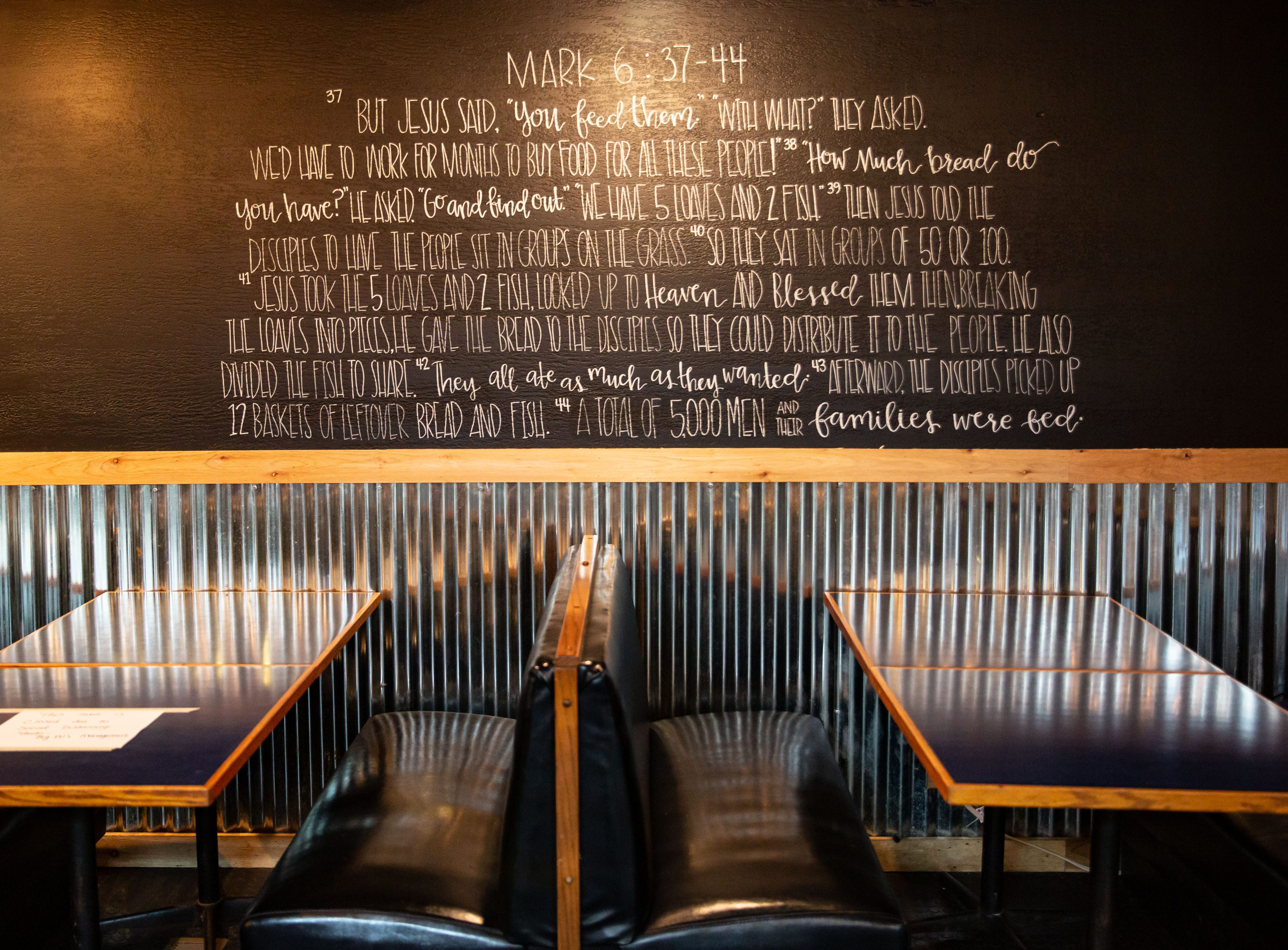 A verse from the gospel of Mark is printed on the wall at Big Al's BBQ in Adel Thursday, Nov. 19, 2020.