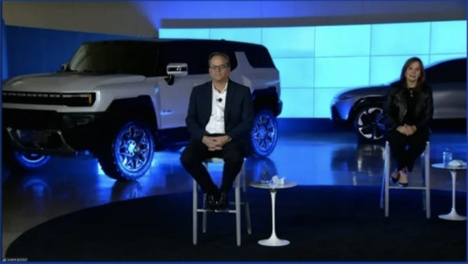 The GM leadership team including CEO Mary Barra sit with the GMC Hummer electric SUV behind them during Thursday's Barclays Global Automotive Conference. This is the first time the public has seen the SUV variant of the electric Hummer.