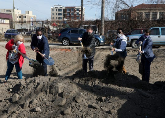 (L to R) Lisa Johanon, Donald Wrencher, Jerry Peterson, PJ Dowdy and Alex Plum all take part in the ground breaking on a large plot of land off of Clairmount Avenue on Friday, Nov 20, 2020 where the $15 million Ruth Ellis Clairmount Center in Detroit will be complete by January of 2022.