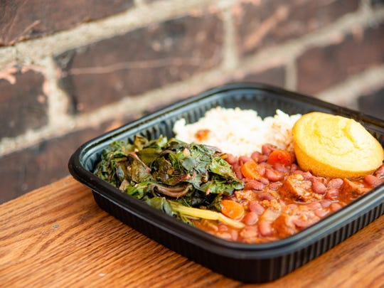 A dish of stew, greens and rice from Paradise Natural Foods.