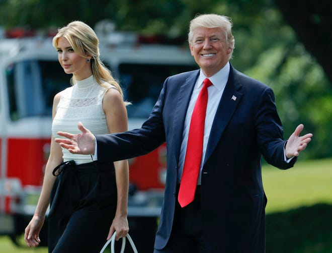 FILE- In this June 13, 2017, file photo, Ivanka Trump joins her father, President Donald Trump, as they walk across the South Lawn of the White House in Washington.