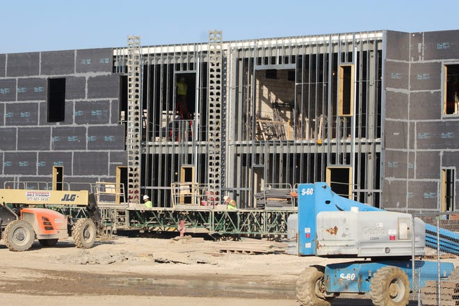 Work continued Friday on the new Fremont Ross High School building. Fremont City Schools' officials expect the new building to be completed by December 2021.