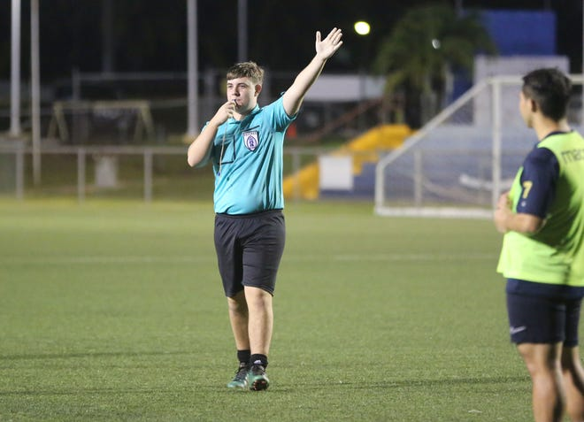 Andrew McCormic signals the team with possession of the ball after calling a foul during a practical session activity of the EAFF Referee Development Programme 2020 at the Guam Football Association National Training Center Sunday.