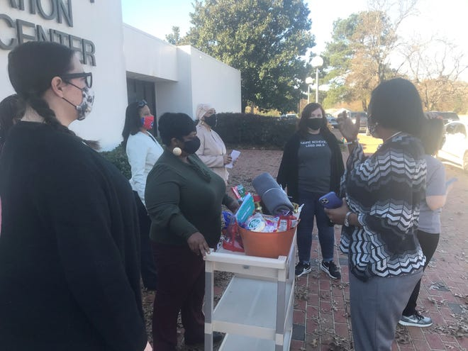 Members of the Jackson Equity Project's education committee deliver a goody basket to the JMCSS Central Office on Thursday before making similar deliveries at every school in the district that day.