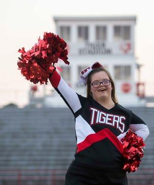 Lillian Heinrich, a  Junior at Lexington High School and a cheerleader for the Lexington football team.