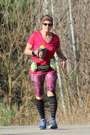 Connie Nunham of Howell ran 5.25-mile loops of Settlers Park in Hartland until she'd completed 100 miles in 40 hours.