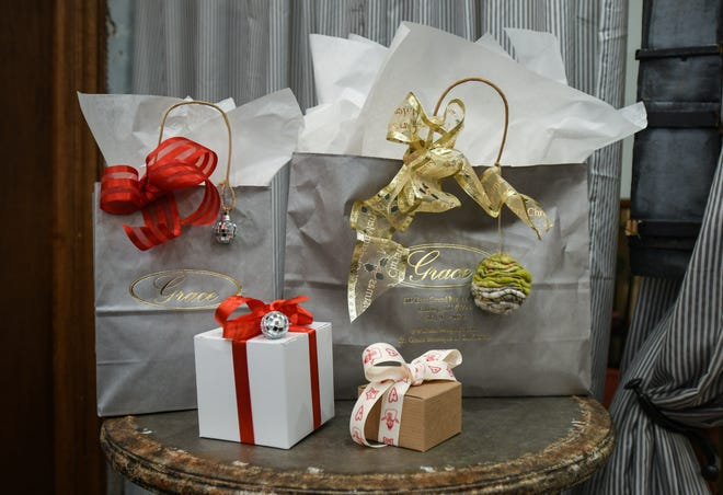 Wrapped gifts ready to be delivered or picked up are displayed at Grace Boutique in Old Town Thursday evening, Nov. 19, 2020, in Lansing.