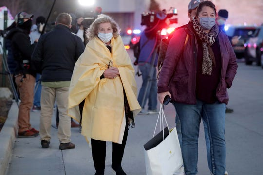Diana Whitfield, left, and her daughter Jill Whitfield-Wooley of Elkhorn leave the Mayfair Mall in Wauwatosa on Friday after several shots inside the mall.  The couple was inside Macy's department store when the shooting took place.