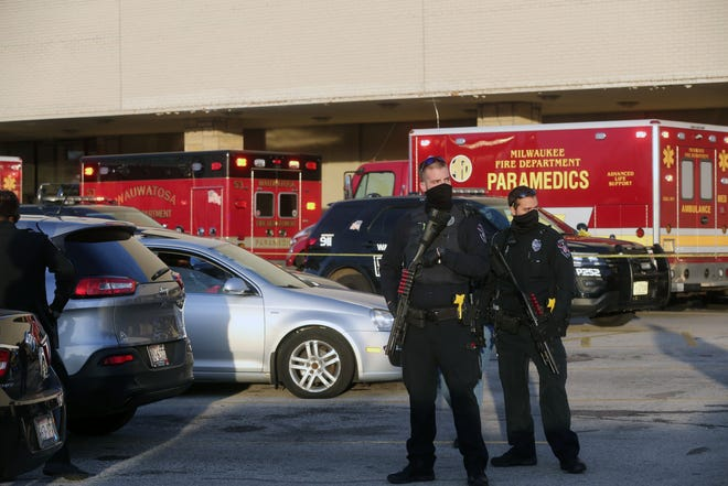 Law enforcement stand by after the shooting Nov. 20 at Mayfair mall. Eight people were shot.