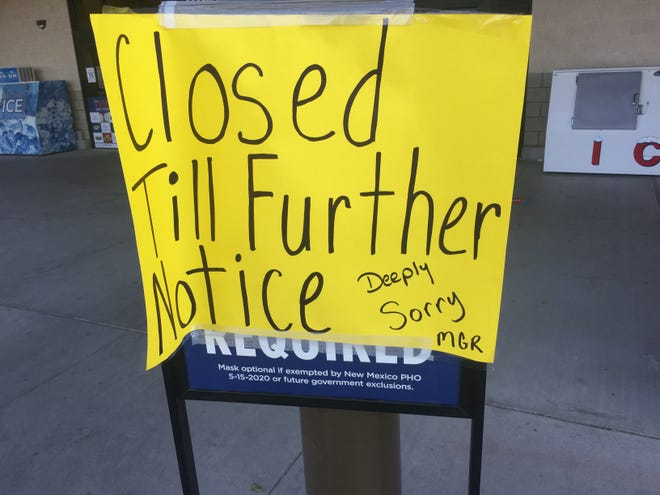 A sign at the Albertsons Market in Carlsbad on Nov. 20, 2020 reminds people the store remains closed due to COVID-19.