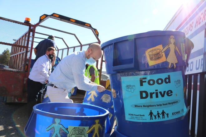San Juan County employees collected food for ECHO Food Bank during a competition with Farmington, Aztec and Bloomfield.