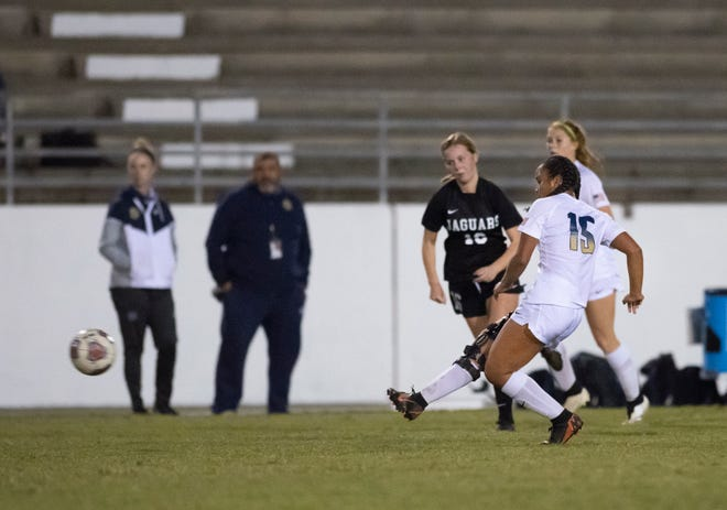 Aila Swinton passes the ball during the Gulf Breeze vs West Florida girls soccer game at West Florida High School in Pensacola on Thursday, Nov. 19, 2020.