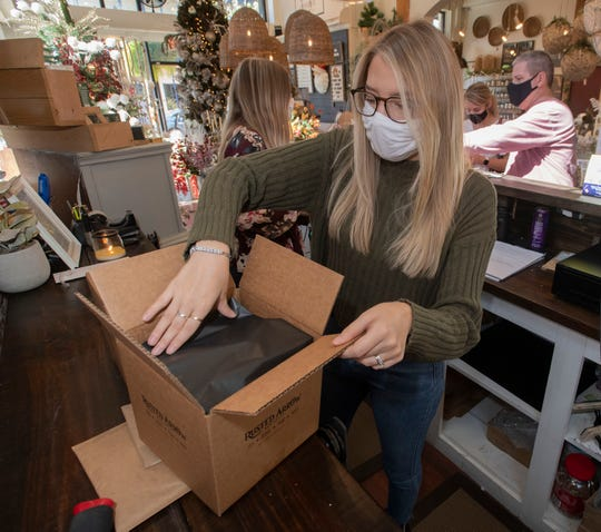 Rusted Arrow Mercantile employee Courtney Holcomb prepares a customer's order for shipment Nov. 20. The downtown Pensacola shop is holding its first-ever Cyber Monday event this year.