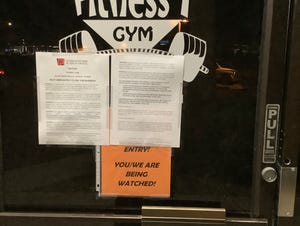 Formal ADHS closure notice placed on front window.