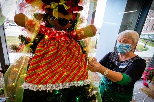 Patricia Toth works to decorate a tree ahead of this year's Festival of Trees Friday, Nov. 20, 2020, at Mclaren Port Huron. This year's event is being held in the hospital's lobby so people can drive or walk by outside the hospital to see the trees.