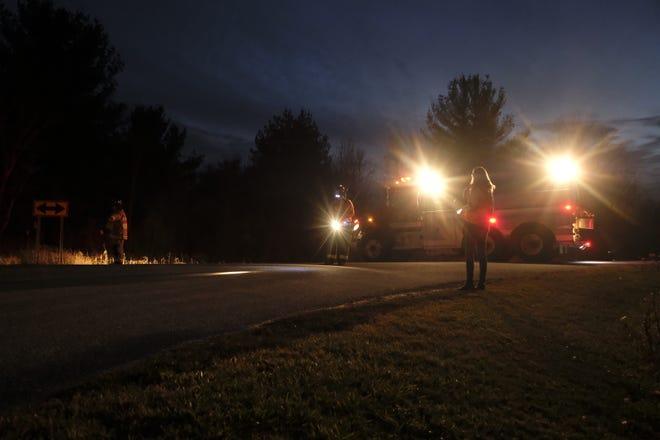 A Kenockee Township firetruck blocks Lapeer Road west of Brandon Road for a crash Friday, Nov. 20, 2020.