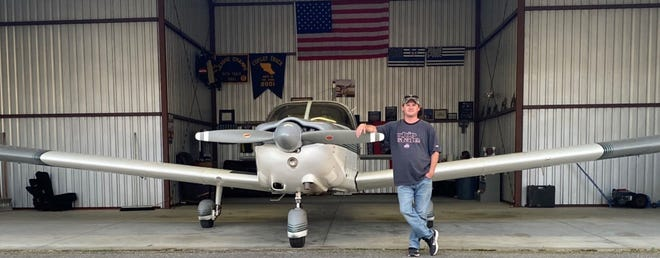 Josh Goodrich of China Township with his Piper Cherokee Six. Goodrich plans to offer private flights in the plane out of the Marine City Airport.