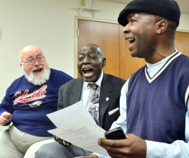 The retired Rev. Albert Davidson Jr., at left, sings with Voni Grimes (center) and Eric D. Smith during a rehearsal of the York County Gospel Choir on Jan. 28, 2013, at Church of the Open Door in West Manchester Twp. (Dispatch file photo)