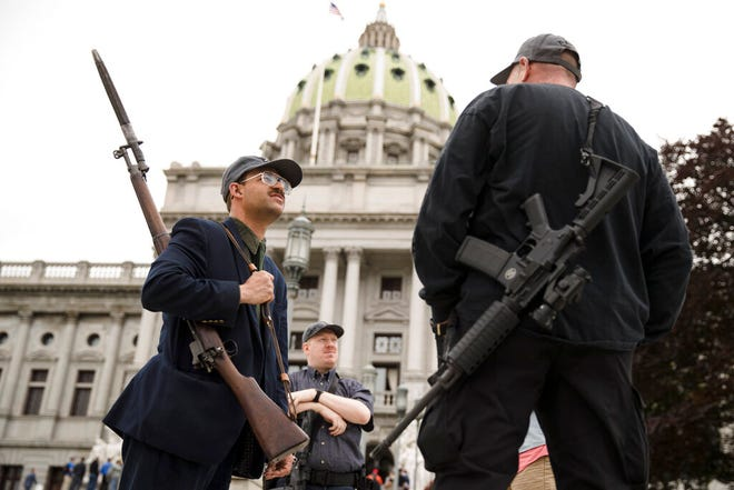 FILE - In this May 6, 2019 file photo, gun rights advocates gather for an annual rally on the steps of the state Capitol in Harrisburg, Pa. Legislation heading to the desk of Gov. Tom Wolf repeals long-standing laws in Pennsylvania intended to control gun-carrying and prevent public officials from shutting down firearms dealers during disaster emergencies declared by a governor.  (AP Photo/Matt Rourke, File)