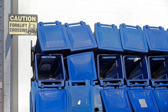 Stacks of Richie Rollers, the city of Richmond's recycling containers, sit on the grounds of the Richmond Sanitary District.
