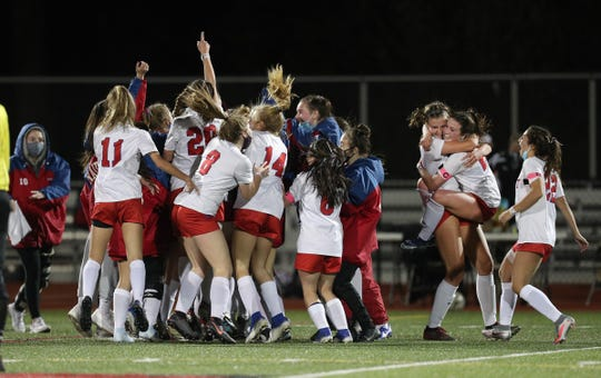 Fairport players celebrate winning the Class AA title with a 1-0 victory over Hilton.  Olivia Kayser scored with 5 seconds remaining in regulation.