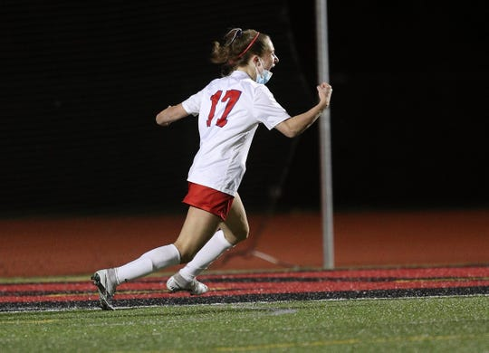 Fairport's Olivia Kayser  celebrates her game winning goal with 5 seconds remaining in regulation to beat Hilton 1-0, winning the Class AA title.