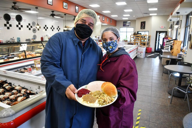 Donald Manea and Sofia Radzak hold a traditional Thanksgiving dinner Wednesday, Nov. 18, 2020, at Manea's Meats in Sauk Rapids. About 150 meals will be distributed to clients of Independent Lifestyles this Thanksgiving.