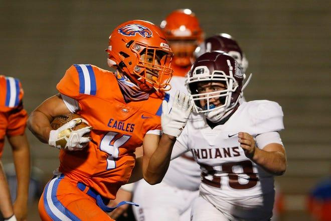 Canutillo's Lj Martin runs the ball during the game against Ysleta in 1-5A, Division II Thursday, Nov. 19, at Canutillo High School in El Paso.