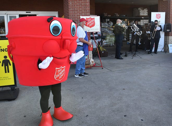 Captain Kettle, the mascot for the Salvation Army Red Kettle campaign, dances as a brass band plays holiday tunes at United Market Street Friday morning in Wichita Falls.