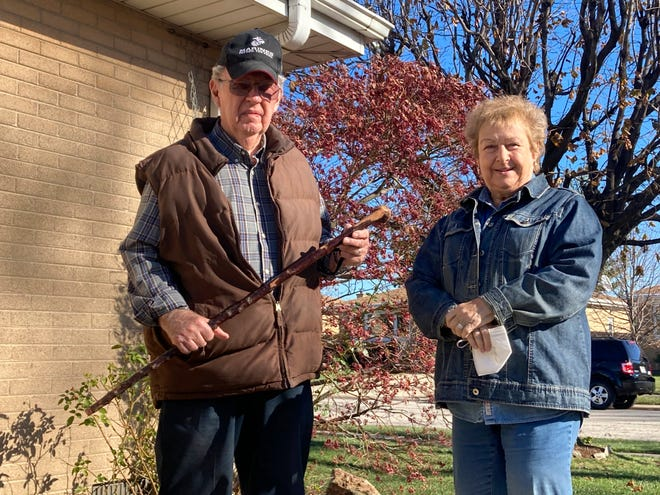 Dan Donovan, joined by his wife, Barbara, holds the antique shillelagh he used to chase burglars from the couple's home even hitting one of the men in the back of the head, Tuesday, Nov. 17, 2020 in Niles, Ill.