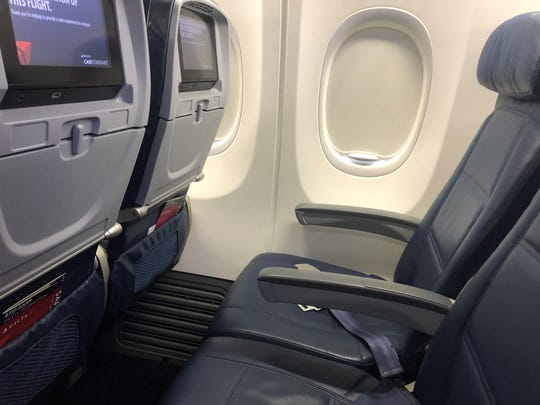 A treat on my Delta flight: two empty seats. The airline is blocking middle seats through March 30.
