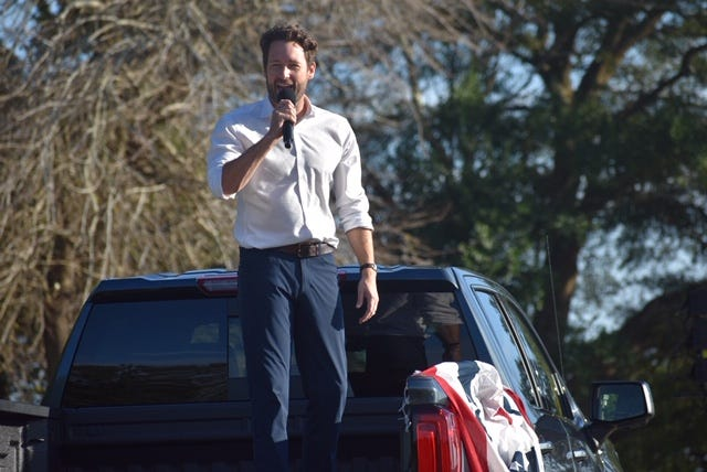 "Rep. Joe Cunningham, a Democrat from South Carolina,  spoke at a campaign rally in North Charleston, Nov. 1, 2020. He called it the ""honor of my lifetime"" to serve with civil rights legends, including Reps. James Clyburn of South Carolina and the late John Lewis of Georgia."