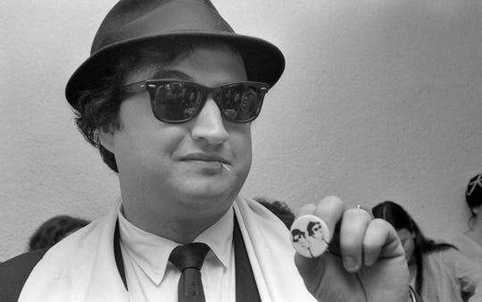 John Belushi front soul band The Blues Brothers as vocalist