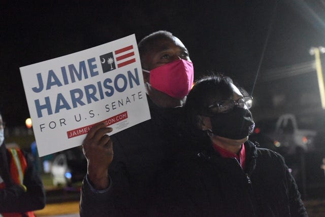 "James and Andria Jeffries attended a campaign rally Nov. 2, 2020 in Orangeburg, South Carolina. The Jeffries said many voters waited for Clyburn's endorsement. ""He's honest and people trust him,""  Andria Jeffries said."